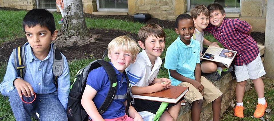 Six Pembroke Hill Lower school students pose on a wall on the Wornall campus
